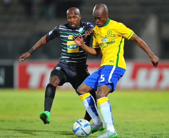 Asavela Mbekile of Mamelodi Sundowns challenged by Tumelo Mogapi of Bloemfontein Celtic during the 2015 MTN8 Quarter Final match between Mamelodi Sundowns and Bloemfontein Celtic at the Lucas Moripe Stadium in Pretoria, South Africa on August 05, 2015