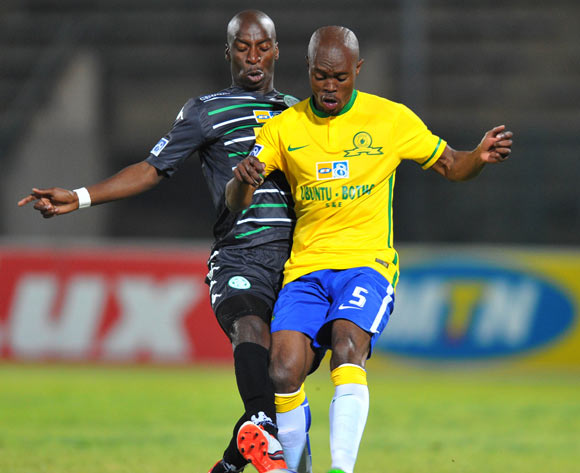 Asavela Mbekile of Mamelodi Sundowns challenged by Musa Nyatama of Bloemfontein Celtic during the 2015 MTN8 Quarter Final match between Mamelodi Sundowns and Bloemfontein Celtic at the Lucas Moripe Stadium in Pretoria, South Africa on August 05, 2015