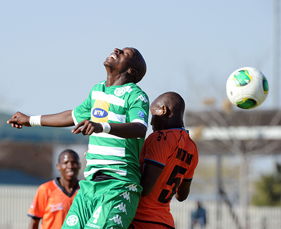 Musa Nyatama of Bloemfontein Celtic is challenged by Lebohang Motumi of Polokwane City  during the Absa Premiership match between Polokwane City and Bloemfontein Celtic  on 08 August 2015 at Goble Park Pic Sydney Mahlangu/ BackpagePix