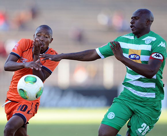 Puleng Tlolane of Polokwane City is challenged by Musa Bilankulu of Bloemfontein Celtic during the Absa Premiership match between Polokwane City and Bloemfontein Celtic  on 08 August 2015 at Old Peter Mokaba Stadium Pic Sydney Mahlangu/ BackpagePix