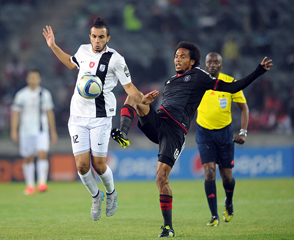 Issa Sarr of Orlando Pirates is challenged by Mohamed Ali Moncer of CS Sfaxien  during the CAF Confederation Cup match between Orlando Pirates and CS Sfaxien on 08 August 2015 at Orlando Stadium Pic Sydney Mahlangu/ BackpagePix