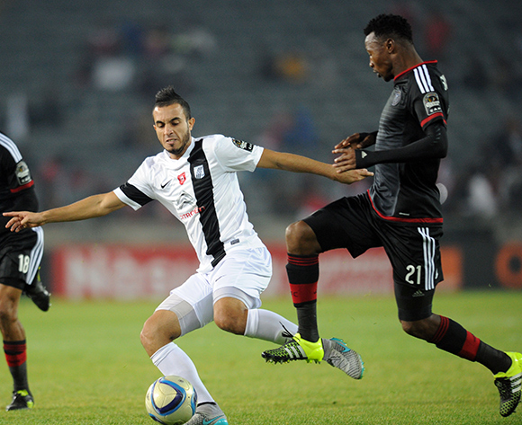 Siyabonga Sangweni of Orlando Pirates is challenged by Mohamed Ali Moncer of CS Sfaxien  during the CAF Confederation Cup match between Orlando Pirates and CS Sfaxien on 08 August 2015 at Orlando Stadium Pic Sydney Mahlangu/ BackpagePix