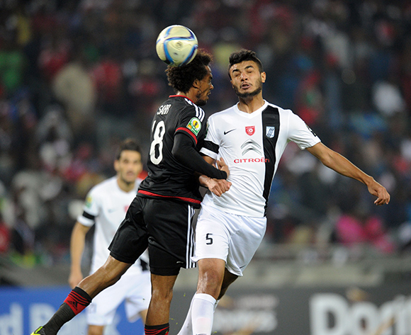 Issa Sarr of Orlando Pirates is challenged by Hamza Hada of CS Sfaxien  during the CAF Confederation Cup match between Orlando Pirates and CS Sfaxien on 08 August 2015 at Orlando Stadium Pic Sydney Mahlangu/ BackpagePix