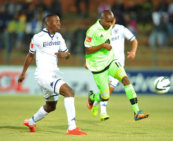 Bantu Mzwakali of Ajax Cape Town challenged by Siyabonga Nhlapho of Bidvest Wits during the Absa Premiership match between Bidvest Wits and Ajax Cape Town at the Bidvest Stadium in Johannesburg, South Africa on August 08, 2015 ©Samuel Shivambu/BackpagePix