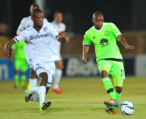 Bantu Mzwakali of Ajax Cape Town challenged by Phumlani Ntshangase of Bidvest Wits during the Absa Premiership match between Bidvest Wits and Ajax Cape Town at the Bidvest Stadium in Johannesburg, South Africa on August 08, 2015 ©Samuel Shivambu/BackpagePix