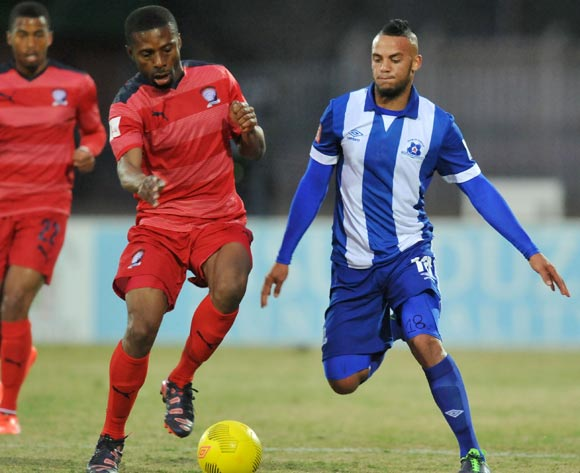 Brice Aka of Jomo Cosmos challenged by Ryan De Jongh of Maritzburg United during the Absa Premiership 2014/15 match between Maritzburg United and Jomo Cosmos at Harry Gwala Stadium in Maritzburg, South Africa on August 11, 2015