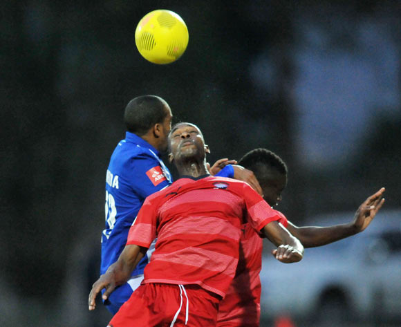 Mxolisi Macuphu of Jomo Cosmos battles with Deolin Mekoa of Maritzburg United during the Absa Premiership 2014/15 match between Maritzburg United and Jomo Cosmos at Harry Gwala Stadium in Maritzburg, South Africa on August 11, 2015