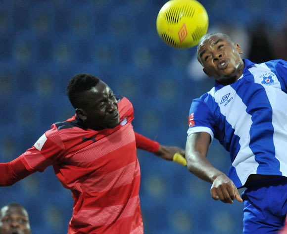 Thamsanqa Teyise of Maritzburg United battles with Frederick Nsabiyumva of Jomo Cosmos during the Absa Premiership 2014/15 match between Maritzburg United and Jomo Cosmos at Harry Gwala Stadium in Maritzburg, South Africa on August 11, 2015
