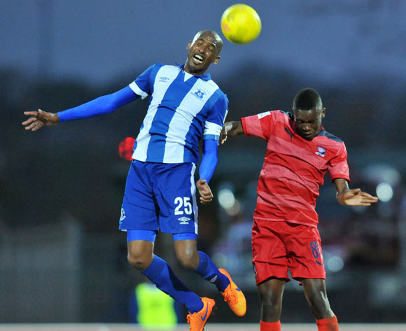 Ashley Hartog of Maritzburg United battles with Wiseman maluleka of Jomo Cosmos during the Absa Premiership 2014/15 match between Maritzburg United and Jomo Cosmos at Harry Gwala Stadium in Maritzburg, South Africa on August 11, 2015