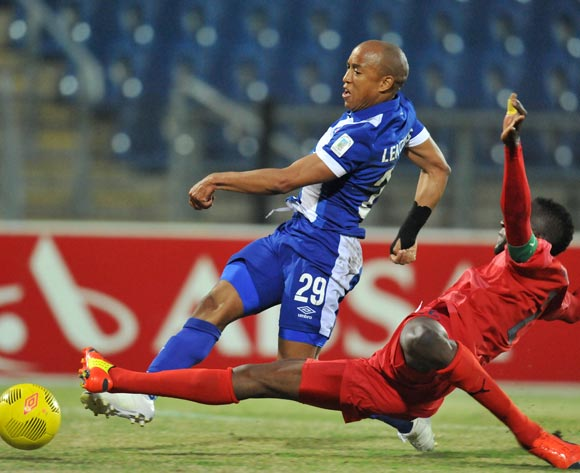 Kurt Lenjties of Maritzburg United tackled by Frederick Nsabiyumva of Jomo Cosmos during the Absa Premiership 2014/15 match between Maritzburg United and Jomo Cosmos at Harry Gwala Stadium in Maritzburg, South Africa on August 11, 2015