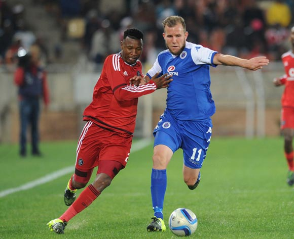 Siyabonga Sangweni of Orlando Pirates  challenges Jeremy Brockie of Supersport United during the Absa Premiership match between Supersport United and Orlando Pirates on 11 August 2015 at Peter Mokaba Stadium