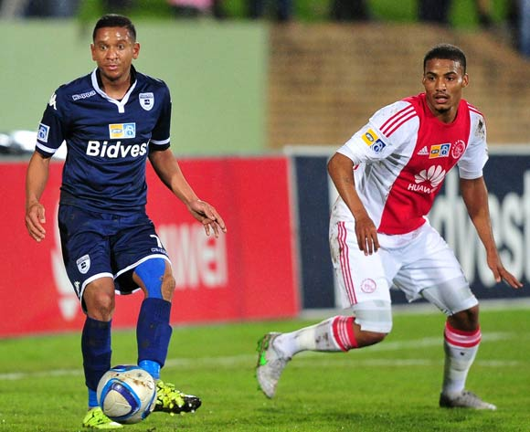 Daine Klate of Bidvest Wits gets his pass away under pressure from Rivaldo Coetzee of Ajax Cape Town during the 2015 MTN8 Semifinal first leg game between Ajax Cape Town and Bidvest Wits at Coetzenburg Stadium, Stellenbosch on 15 August 2015