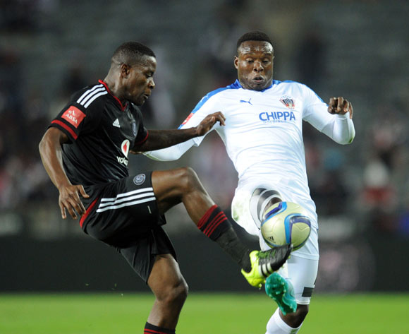 Rhulani Manzini of Chippa United challenges for the ball with Ntsikelelo Nyauza of Orlando Pirates during the Absa Premiership match between Orlando Pirates and Chippa United on 18 August 2015 at Orlando Stadium