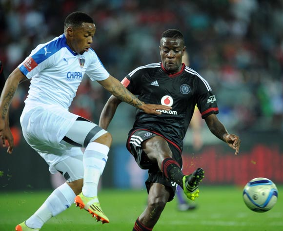 Edward Manqele of Chippa United is challenged by Ntsikelelo Nyauza of Orlando Pirates during the Absa Premiership match between Orlando Pirates and Chippa United on 18 August 2015 at Orlando Stadium