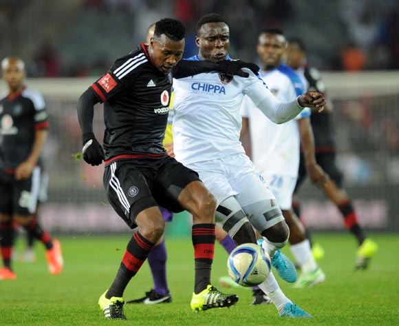 Rhulani Manzini of Chippa United challenges for the ball with Siyabonga Sangweni of Orlando Pirates during the Absa Premiership match between Orlando Pirates and Chippa United on 18 August 2015 at Orlando Stadium