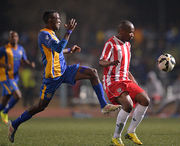 Gofaone Tiro of Township Rollers and  Tebogo Toy Moroka of Jwaneng Galaxy FC during the 2015/16 beMobile Premiership football match between Township Rollers and Jwaneng Galaxy FC at Molepolole Sports Complex , Botswana on  August 21, 2015.  ©Monirul Bhuiyan/BackpagePix