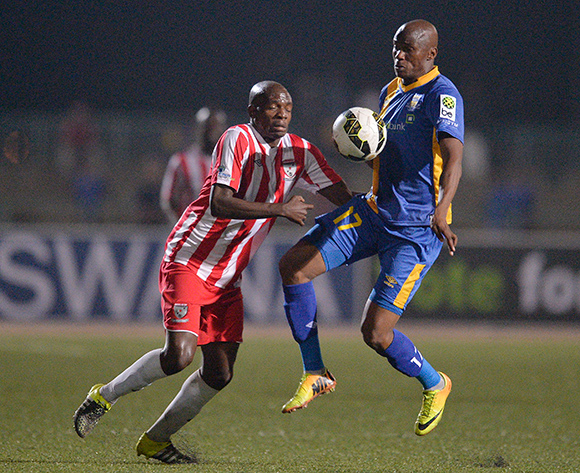 Joel Mogorosi of Township Rollers and Mosimanegape Chippa Ngongorego  of Jwaneng Galaxy FC during the 2015/16 beMobile Premiership football match between Township Rollers and Jwaneng Galaxy FC at Molepolole Sports Complex , Botswana on  August 21, 2015.  ©Monirul Bhuiyan/BackpagePix