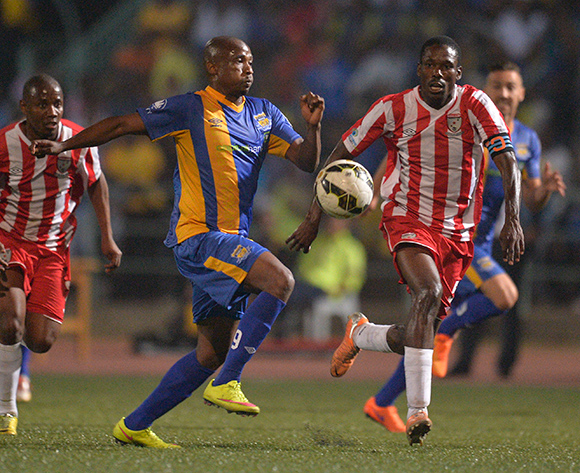 Jerome Ramatlhakwana of Township Rollers and  Boitumelo Navara Mafoko of Jwaneng Galaxy FC during the 2015/16 beMobile Premiership football match between Township Rollers and Jwaneng Galaxy FC at Molepolole Sports Complex , Botswana on  August 21, 2015.  ©Monirul Bhuiyan/BackpagePix