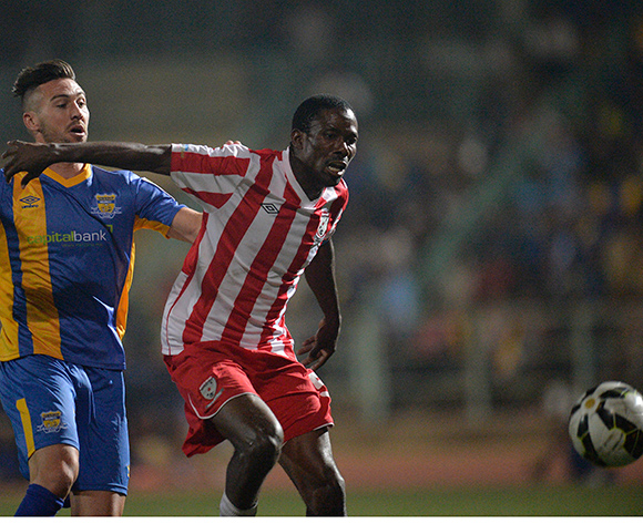 Carl Finnigan of Township Rollers and  Boitumelo Navara Mafoko of Jwaneng Galaxy FC during the 2015/16 beMobile Premiership football match between Township Rollers and Jwaneng Galaxy FC at Molepolole Sports Complex , Botswana on  August 21, 2015.  ©Monirul Bhuiyan/BackpagePix