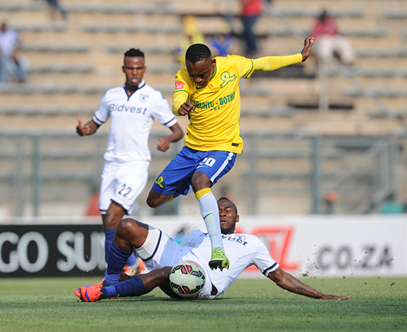 Khama Billiat of Mamelodi Sundowns evades a tackle from Onismor Bhasera of Bidvest Wits during the Absa Premiership match between Mamelodi Sundowns and Bidvest Wits on 22 August 2015 at Lucas Moripe Stadium Pic Sydney Mahlangu/ BackpagePix