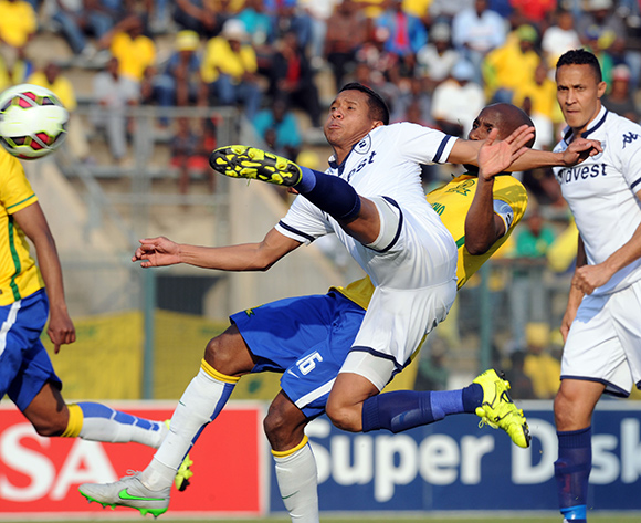 Daine Klate of Bidvest Wits takes a shot ahead of  Ramahlwe Mphahlele of Mamelodi Sundowns during the Absa Premiership match between Mamelodi Sundowns and Bidvest Wits on 22 August 2015 at Lucas Moripe Stadium Pic Sydney Mahlangu/ BackpagePix