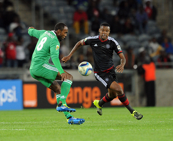 Michael Ndougsa of AC Leopards is challenged by Thamsanqa Gabuza of Orlando Pirates  during the CAF Confederation Cup match between Orlando Pirates and AC Leopards  on 22 August 2015 at Lucas Moripe Stadium Pic Sydney Mahlangu/ BackpagePix