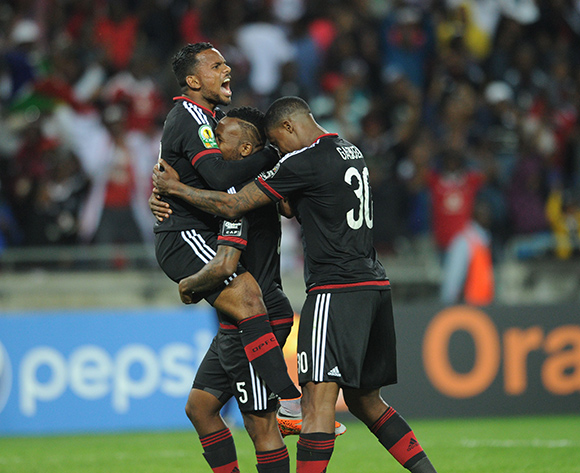 Mpho Makola of Orlando Pirates (m) celebrates a goal with teammates during the CAF Confederation Cup match between Orlando Pirates and AC Leopards  on 22 August 2015 at Lucas Moripe Stadium Pic Sydney Mahlangu/ BackpagePix