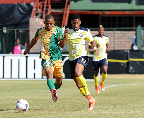 Matsilele Sono Junior of Jomo Cosmos  challenges for the ball with Gladwin Shitolo of Golden Arrows during the Absa Premiership match between Jomo Cosmos  and Golden Arrows   on 23 August 2015 at Olen Park Pic Sydney Mahlangu/ BackpagePix