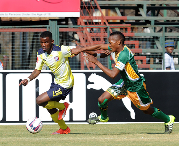 Tebogo Makobela of Jomo Cosmos is challenged by Matome Mathiane of Golden Arrows  during the Absa Premiership match between Jomo Cosmos  and Golden Arrows   on 23 August 2015 at Olen Park Pic Sydney Mahlangu/ BackpagePix