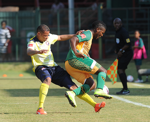 Mabhudi Khenyeza of Golden Arrows is tackled by Cheslyn Jampies of Jomo Cosmos during the Absa Premiership match between Jomo Cosmos  and Golden Arrows   on 23 August 2015 at Olen Park Pic Sydney Mahlangu/ BackpagePix