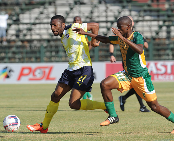 Brice Aka of Jomo Cosmos  is challenged by  Nkayinso Mngwengwe of Golden Arrows during the Absa Premiership match between Jomo Cosmos  and Golden Arrows   on 23 August 2015 at Olen Park Pic Sydney Mahlangu/ BackpagePix