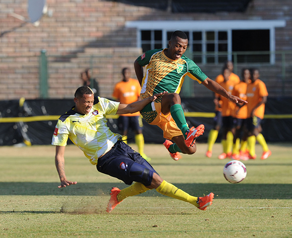 Thembela Sikhakhane of Golden Arrows is tackled by Cheslyn Jampies of Jomo Cosmos during the Absa Premiership match between Jomo Cosmos  and Golden Arrows   on 23 August 2015 at Olen Park Pic Sydney Mahlangu/ BackpagePix