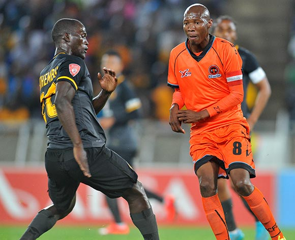 Jabulani Maluleke of Polokwane City challenged by Siphelele Mthembu of Kaizer Chiefs  during the Absa Premiership match between Polokwane City and Kaizer Chiefs at the Peter Mokaba Stadium in Limpopo, South Africa on August 25, 2015 ©Samuel Shivambu/BackpagePix