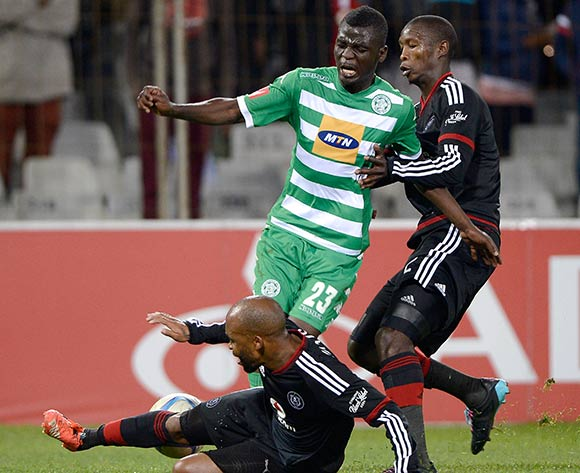 Vusi Shikweni from Bloemfontein Celtic FC tackled by Ayanda Gcaba and Oupa Manyisa of Orlando Pirates during the Absa Premiership match between Bloemfontein Celtic FC and Orlando Pirates FC at the Free State Stadium  on 26 August 2015. ©Gerhard Steenkamp/Backpage Media