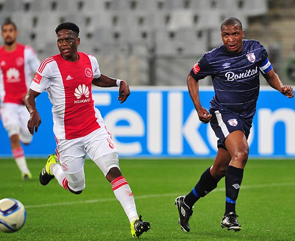 Paulus Masehe of Free State Stars clears the ball ahead of Ndiviwe Mdabuka of Ajax Cape Town during the Absa Premiership 2015/16 game between Ajax  Cape Town and Free State Stars at Cape Town Stadium on the 26 of August 2015 ©Ryan Wilkisky/BackpagePix