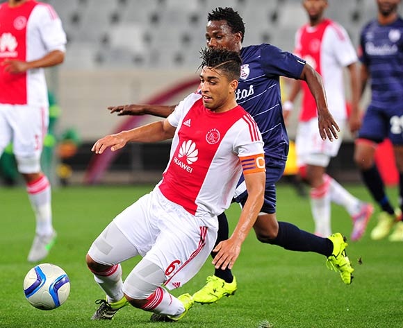 Travis Graham of Ajax Cape Town gets to the ball ahead of Mrisho Ngasa of Free State Stars during the Absa Premiership 2015/16 game between Ajax  Cape Town and Free State Stars at Cape Town Stadium on the 26 of August 2015 ©Ryan Wilkisky/BackpagePix