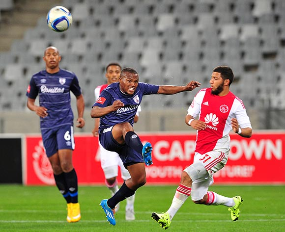 Angelo Kerspuy of Free State Stars clears the ball ahead of Riyaad Norodien of Ajax Cape Town during the Absa Premiership 2015/16 game between Ajax  Cape Town and Free State Stars at Cape Town Stadium on the 26 of August 2015 ©Ryan Wilkisky/BackpagePix