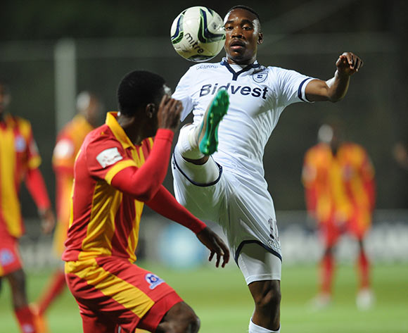 Sibusiso Vilakazi of Bidvest Wits is challenged by Philani Zulu of Maritzburg United during the Absa Premiership match between Bidvest Wits and Maritzburg United  on 26 August 2015 at Bidvest Stadium Pic Sydney Mahlangu/ BackpagePix