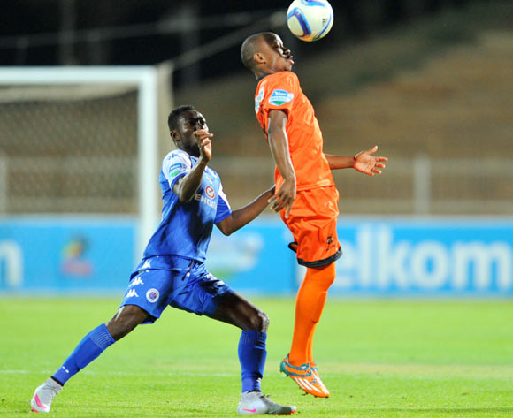 Puleng Tlolane of Polokwane City challenged by Dove Wome of Supersport United during the 2015 Telkom Knockout match between Polokwane City and Supersport United at the Old Peter Mokaba Stadium in Polokwane, South Africa on September 30, 2015 ©Samuel Shivambu/BackpagePix