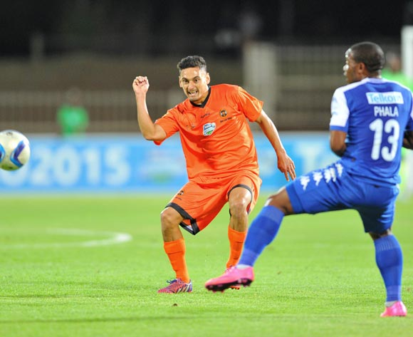 Cole Alexander of Polokwane City challenged by Thuso Phala of Supersport United during the 2015 Telkom Knockout match between Polokwane City and Supersport United at the Old Peter Mokaba Stadium in Polokwane, South Africa on September 30, 2015 ©Samuel Shivambu/BackpagePix