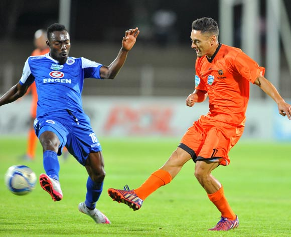 Cole Alexander of Polokwane City challenged by Dove Wome of Supersport United during the 2015 Telkom Knockout match between Polokwane City and Supersport United at the Old Peter Mokaba Stadium in Polokwane, South Africa on September 30, 2015 ©Samuel Shivambu/BackpagePix