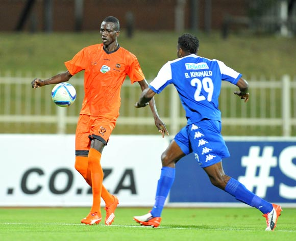 Baptiste Faye of Polokwane City challenged by Bongani Khumalo of Supersport United during the 2015 Telkom Knockout match between Polokwane City and Supersport United at the Old Peter Mokaba Stadium in Polokwane, South Africa on September 30, 2015 ©Samuel Shivambu/BackpagePix