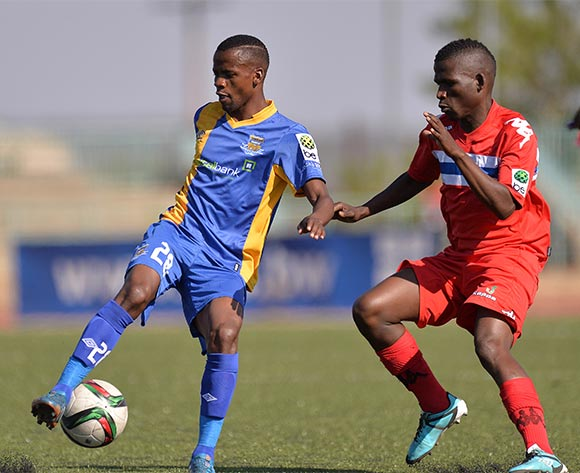 Motsholetsi Sikele of Township Rollers and  Kediemetse Radikoko of FC Satmos during the 2015/16 beMobile Premiership football match between Township Rollers and FC Satmos  at Molepolole Sports Complex , Botswana on  September 27, 2015.  ©Monirul Bhuiyan/BackpagePix