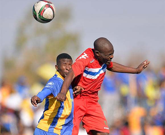 Kaone Vanderwesthuizen of Township Rollers and  Kabelo Ranji of FC Satmos during the 2015/16 beMobile Premiership football match between Township Rollers and FC Satmos  at Molepolole Sports Complex , Botswana on  September 27, 2015.  ©Monirul Bhuiyan/BackpagePix