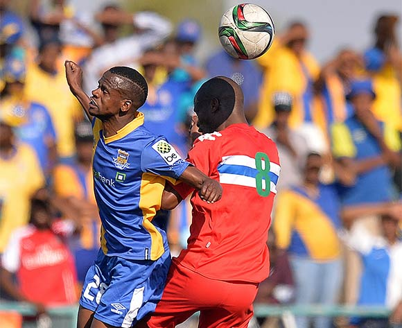 Motsholetsi Sikele of Township Rollers and  Kagiso Tutuwe of FC Satmos during the 2015/16 beMobile Premiership football match between Township Rollers and FC Satmos  at Molepolole Sports Complex , Botswana on  September 27, 2015.  ©Monirul Bhuiyan/BackpagePix