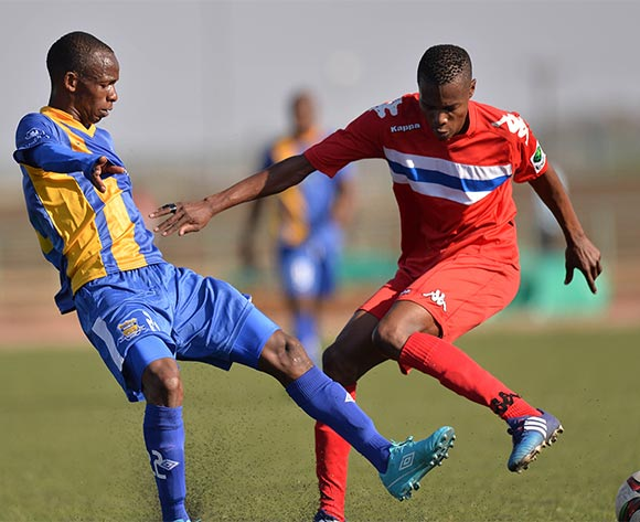 Maano Ditshupo of Township Rollers and  Mogakolodi Balatotse of FC Satmos during the 2015/16 beMobile Premiership football match between Township Rollers and FC Satmos  at Molepolole Sports Complex , Botswana on  September 27, 2015.  ©Monirul Bhuiyan/BackpagePix