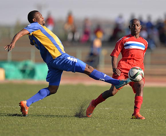Tshepo Mothlabankwe of Township Rollers and  Melvin Moyo of FC Satmos during the 2015/16 beMobile Premiership football match between Township Rollers and FC Satmos  at Molepolole Sports Complex , Botswana on  September 27, 2015.  ©Monirul Bhuiyan/BackpagePix