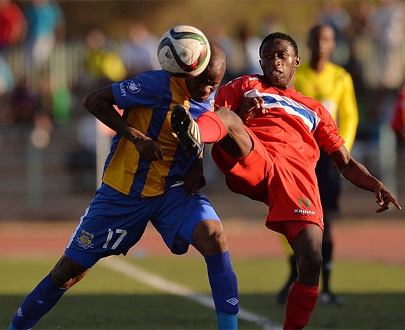 Joel Mogorosi of Township Rollers and Melvin Moyo of FC Satmos during the 2015/16 beMobile Premiership football match between Township Rollers and FC Satmos  at Molepolole Sports Complex , Botswana on  September 27, 2015.  ©Monirul Bhuiyan/BackpagePix
