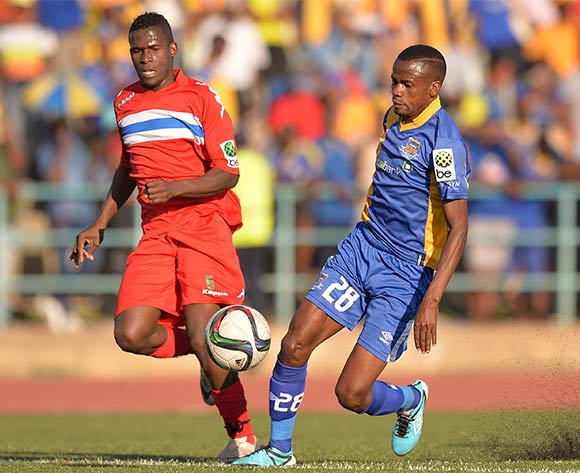 Motsholetsi Sikele of Township Rollers and  Bokamoso Digwere of FC Satmos during the 2015/16 beMobile Premiership football match between Township Rollers and FC Satmos  at Molepolole Sports Complex , Botswana on  September 27, 2015.  ©Monirul Bhuiyan/BackpagePix