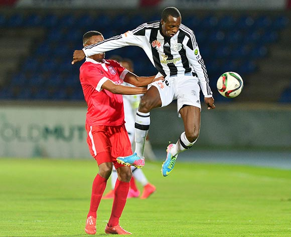 Tendai Nyumasi of Mochudi Chiefs clears ball from Thato Ogopotse of Gaborone United during the 2015/16 beMobile Premiership football match between Mochudi Chiefs and Gaborone United at the National Stadium in Gaborone on 12 September 2015 ©Gavin Barker/BackpagePix